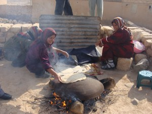 Women cook bread in Syria